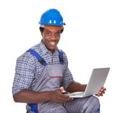 Male craftsman holding laptop royalty free stock images