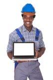 Male Craftsman Holding Laptop royalty free stock image