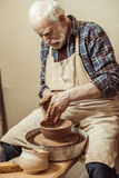 Male craftsman working on potters wheel Royalty Free Stock Images