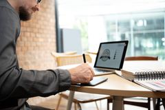 Concentrated Male Designer working. stock image