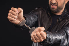 Male criminal getting rid of handcuffs Stock Images