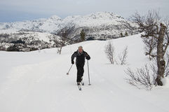 Male cross country skier. A male cross country skier alone in the mountains Stock Image