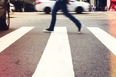 Male is crossing the street. Man crossing the street. Heavy traffic in urban area.  Color filter Stock Images
