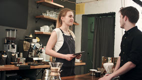 Male customer asking barista to make coffee in cafeteria Royalty Free Stock Images