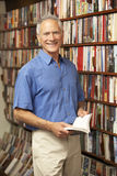 Male customer in bookshop. Smiling at camera Stock Images