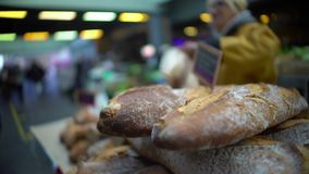 Male customer buying freshly baked bread at market, healthy lifestyle and food. Stock footage stock video