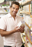 Male customer buying herbal tea Royalty Free Stock Image