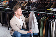 Male customer examining trousers in men's cloths store Stock Photo