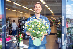 Male Customer Holding Flowering Plants In Shop Stock Images