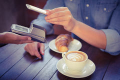 Male customer paying with smartphone. At coffee shop Stock Images