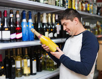 Male customer purchasing at wine section Stock Photo