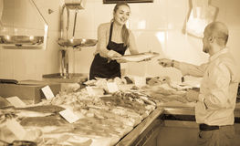 Male customer selecting cooled fish in local fishery Stock Photos