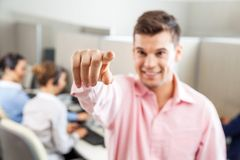 Male Customer Service Executive Pointing At You Stock Photo