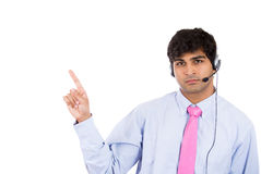 Male customer service representative or call centre worker or operator or support staff pointing Stock Photography