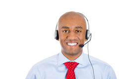 Male customer service representative or call centre worker or operator or support staff speaking with head set. Closeup portrait of male customer service Stock Photos