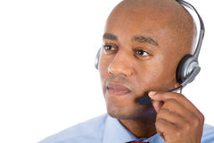 Male customer service representative or call centre worker or operator or support staff speaking with head set. Closeup portrait of male customer service Royalty Free Stock Photography