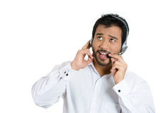 Male customer service representative looking upwards and having a conversation with his customer Royalty Free Stock Images