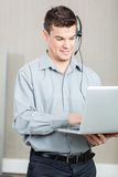 Male Customer Service Representative Using Laptop Royalty Free Stock Photos