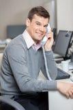 Male Customer Service Representative Using Stock Photography
