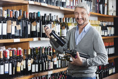 Male Customer Shopping For Wine Bottles In Store Royalty Free Stock Photography