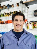 Male Customer Smiling In Hardware Shop Stock Image