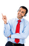 Male customer support member pointing at a copy space Royalty Free Stock Photography