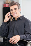 Male Customer Using Cellphone At Salon Royalty Free Stock Images