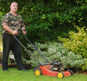 Male cutting mowing the grass. In garden Royalty Free Stock Image