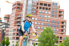 Male cycling downtown Stock Image