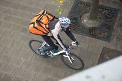 Male Cyclist With Backpack On Sidewalk Stock Image