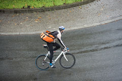 Male Cyclist With Backpack On Street Royalty Free Stock Photo