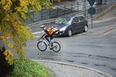Male Cyclist With Backpack On Street Stock Image
