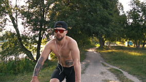 Male cyclist begins to ride on the road stock video footage