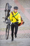 Male Cyclist With Bicycle And Courier Bag Walking Royalty Free Stock Photo