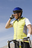Male Cyclist On Call Stock Photo