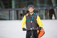 Male Cyclist Carrying Courier Delivery Bag Stock Photography