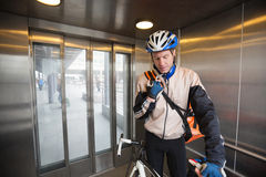 Male Cyclist With Courier Bag In An Elevator Stock Photo