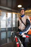 Male Cyclist With Courier Bag Riding In An Stock Photo