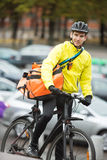 Male Cyclist With Courier Delivery Bag On Street Stock Images