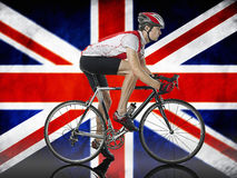 Male Cyclist cycling in front of Union Jack Flag Royalty Free Stock Photography