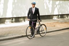Male cyclist with his bicycle on road Royalty Free Stock Images