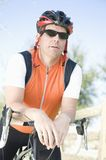 Male cyclist leaning on handlebars Royalty Free Stock Images
