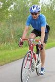 Male cyclist. On a race bike Stock Image