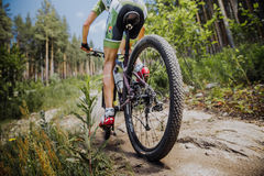 Male cyclist riding a bike. Male athlete cyclist riding a bike, rear wheel Stock Photo
