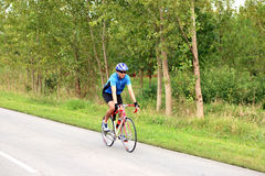 Male cyclist riding a bike. On an road Stock Photos