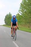Male cyclist riding a bike Stock Photo