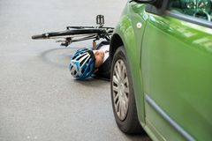 Male cyclist after road accident Stock Images
