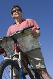 Male Cyclist With Road Map And Bicycle Stock Photography