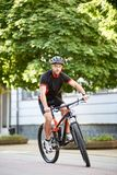 Male cyclist training in city center stock photo