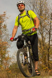 Male cyclist traveling with bike. Royalty Free Stock Photo